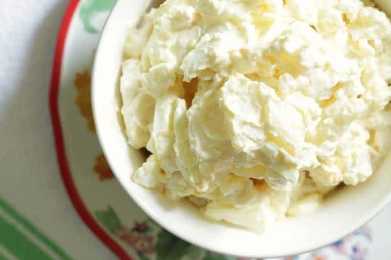 Grandma's Best Old-Fashioned Potato Salad - in bowl on plate