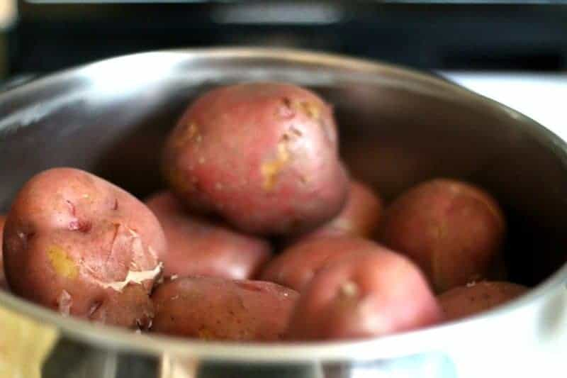 Red potatoes cooked, drained, and ready to peel for best old-fashioned potato salad