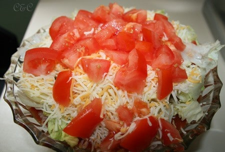 side top view of 7-layer bean dip in a glass bowl