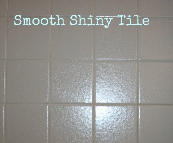 Smooth and shiny clean bathroom shower wall after using DIY soap scum remover and cleaner