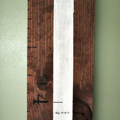 Wooden ruler growth chart.