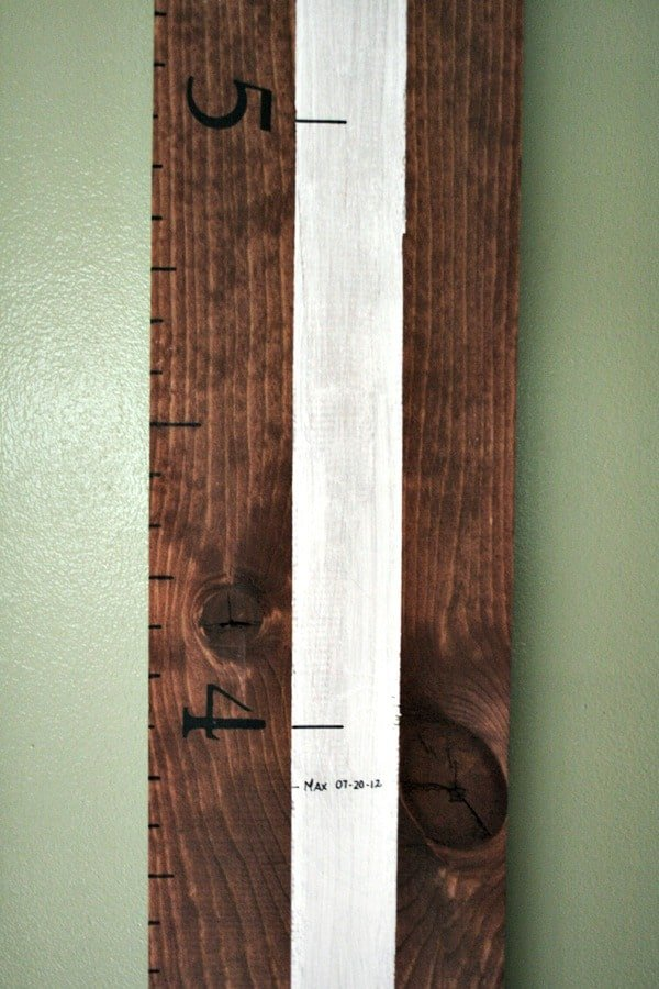 Wooden ruler growth chart.