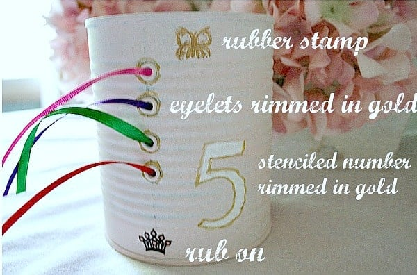 tin can ribbon organizer complete with ribbons drawn through metal eyelet holes