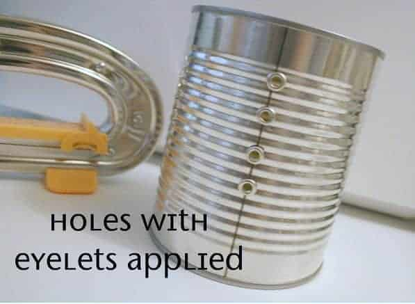 tin can ribbon organizer with holes punched and metal eyelets in place