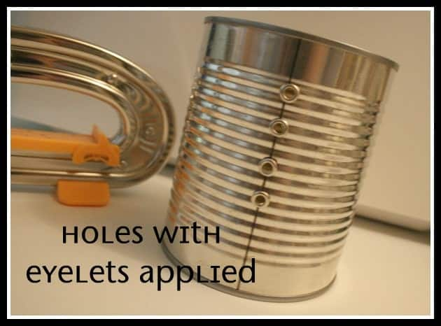Holes punched in tin can with a crop-a-dile to use as a ribbon organizer