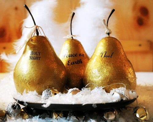 Brighten up your decor this Holiday Season with these DIY Faux Gilded Pears made from papier mache fruit, gold paint and Mod Podge. Get the full tutorial at www.cupcakesandcrinoline.com