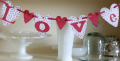 Love Banner made from scrapbook paper @ cupcakesandcrinoline.com
