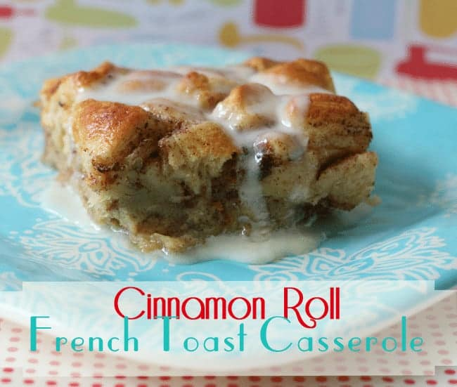 Side view of cinnamon roll French Toast Casserole on a blue and white boho style plate with powdered sugar icing pouring over the top and pooling on the sides