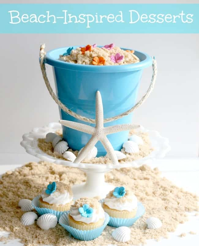 "Oreo Dirt Pudding in a sand bucket with edible sugar flowers, seashells, and ""sand"" with mini Beach Inspired Cupcakes"