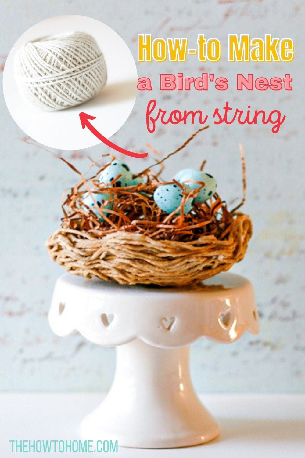ball of white string above a bird's nest made from twine on a cupcake pedestal