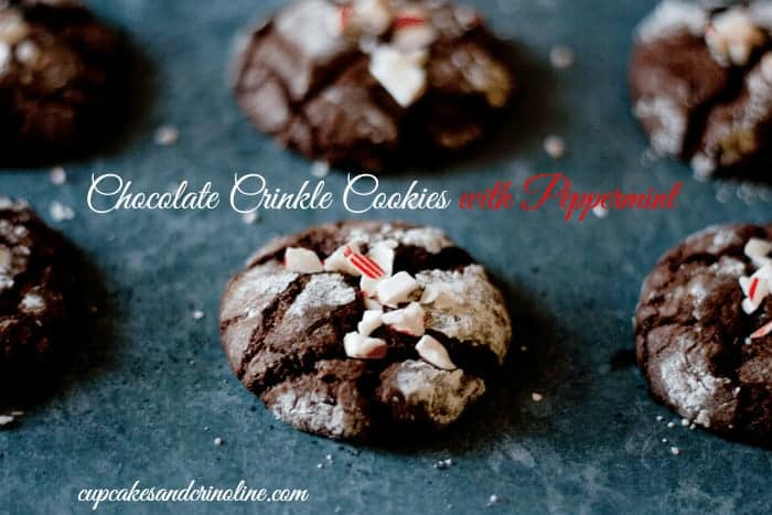 Close of of chocolate crinkle cookies with a peppermint twist fresh out of oven on soapstone baking sheet