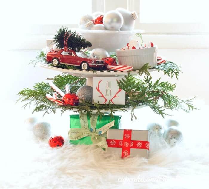 Christmas Trees on Cars Centerpiece from cupcakesandcrinoline.com