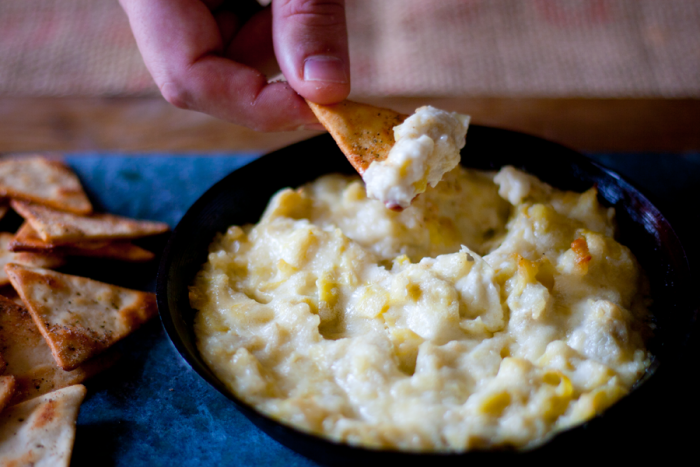 Hot Artichoke Dip. A delicious appetizer that's easy to make with only 4 ingredients. Rich and delicious and a favorite with guests. Perfect for holiday entertaining. cupcakesandcrinoline.com