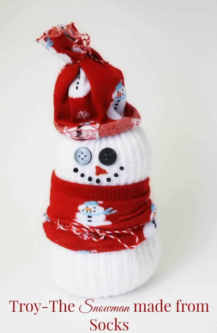 Snowman Made from Socks at cupcakesandcrinoline.com