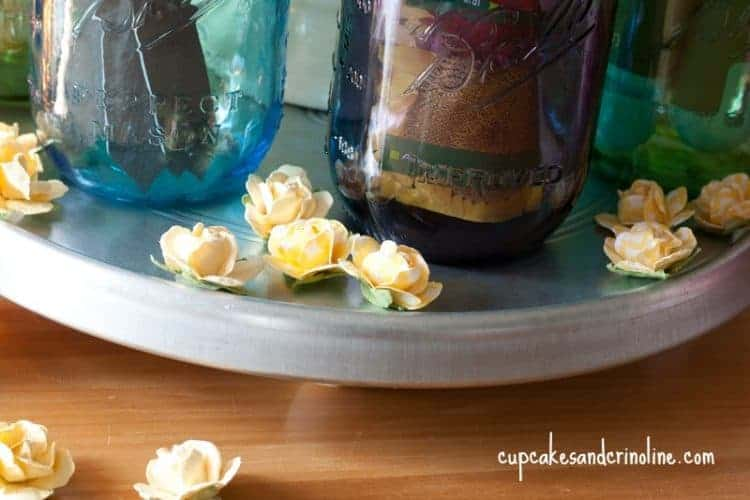 Mason Jar Gifts for the gardener - beautiful and colorful mason jars filled with gifts for gardening enthusiasts. - Mason Jar Mother's Day ~ cupcakesandcrinoline.com yellow paper roses