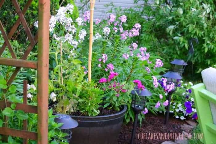 The Secret to Creating a Cozy and Charming Outdoor Space ~ flowerbed mix of annuals and perennials cupcakesandcrinoline.com