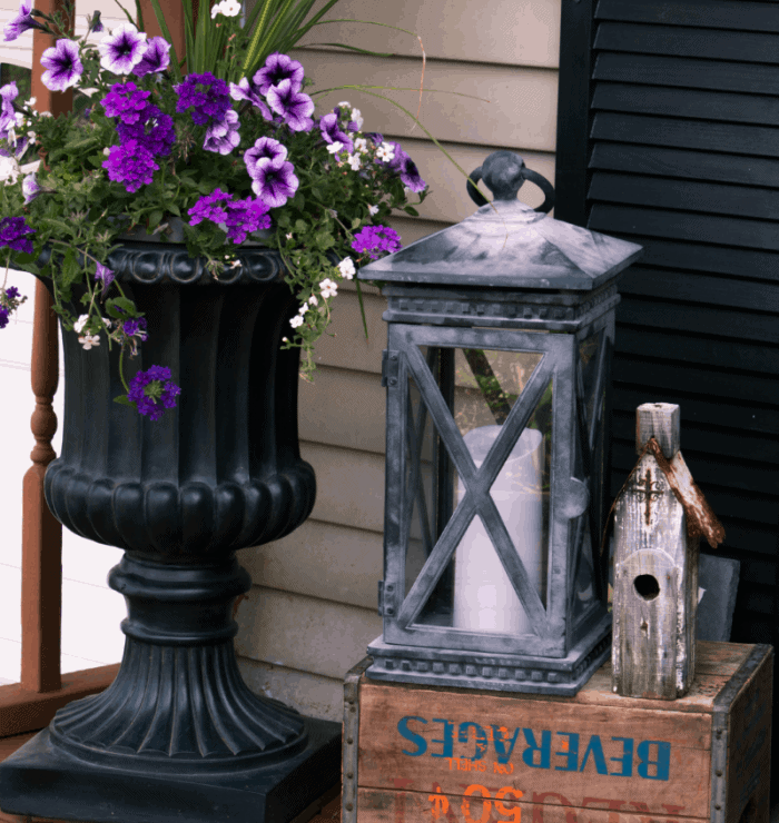 Front porch decor ~ lantern with candle on a vintage soda pop box with an old wooden church from cupcakesandcrinoline.com