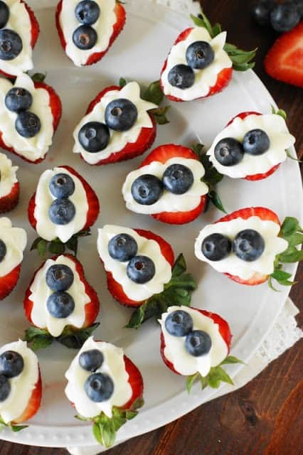 Red, white, and blue strawberry cheesecake bites
