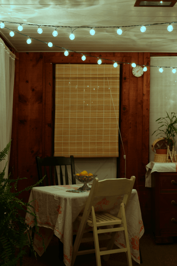 Sunroom after hours with string lights cupcakesandcrinoline.com