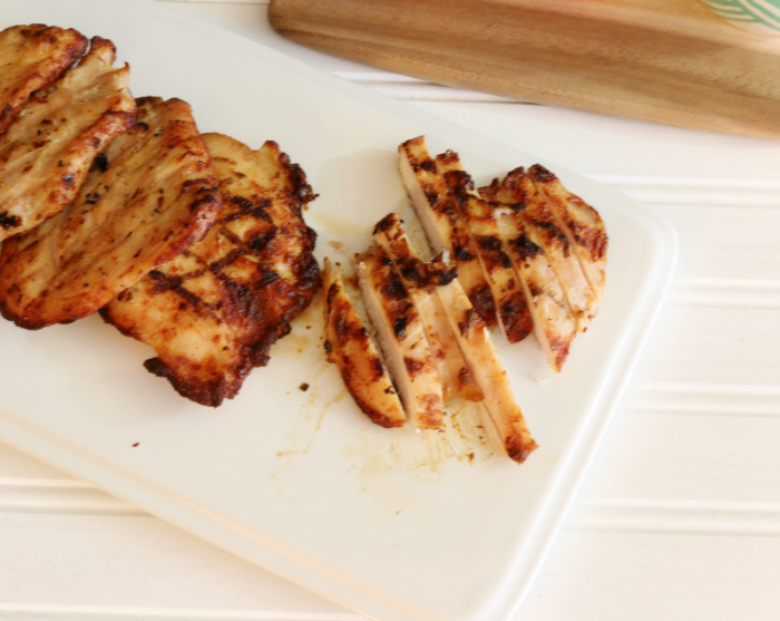 Tyson Grilled & Ready Chicken Breast Fillets sliced and ready to be placed on a quick and easy Mediterranean Chicken Salad