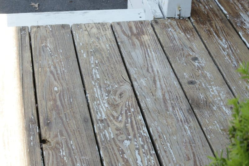 Deck makeover ~ deck after stripped and priming and before painting with Behr DeckOver at cupcakesandcrinoline.com