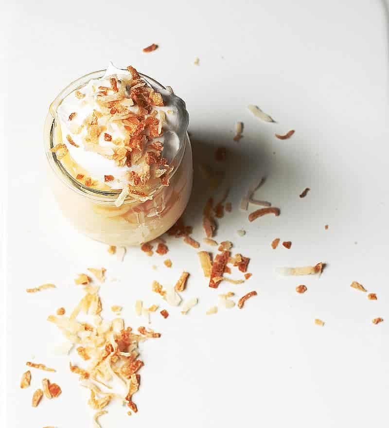 Fresh toasted coconut served atop whipped cream, caramel sauce and tapioca pudding ~ cupcakesandcrinoline.com