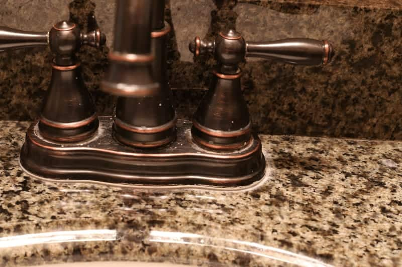 Sink before using Zep with lime deposits on granite - how to remove water stains and hard water deposits from granite