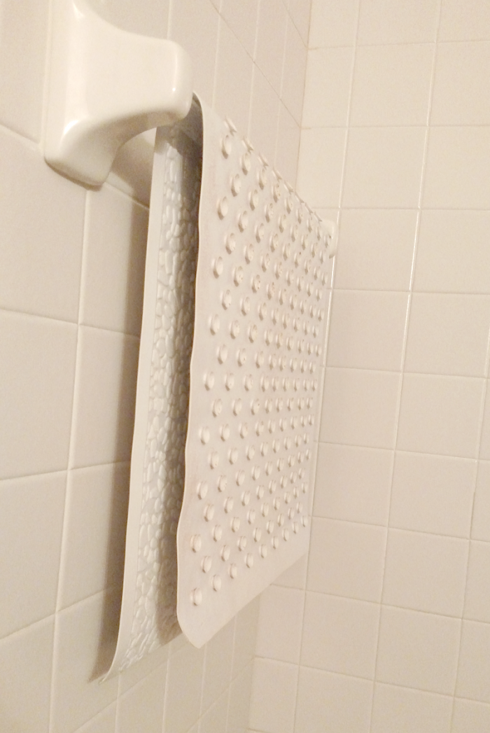 25 things you should be disinfecting but probasbly aren't - shower mat - get the complete list at cupcakesandcrinoline.com