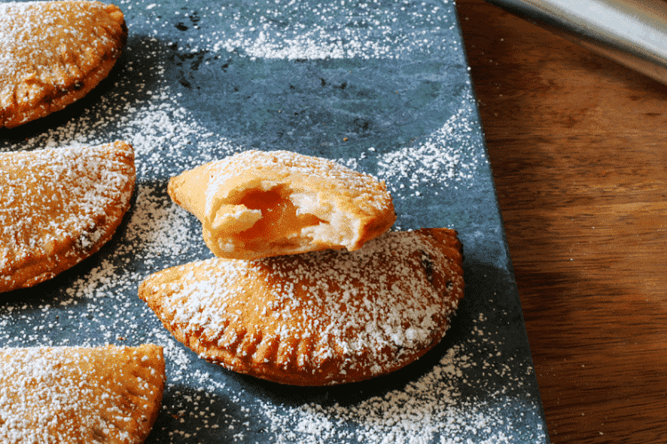 Peach Pie Pocket Recipe deep fried and coated with powdered sugar