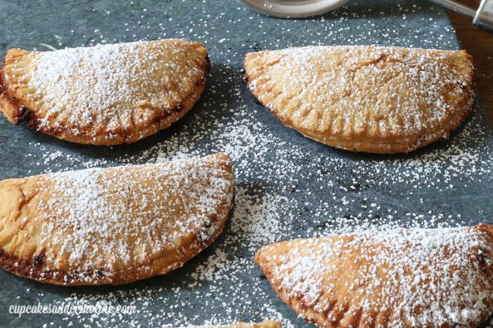 Fresh peach pies with powdered sugar - get the recipe at cupcakesandcrinoline.com