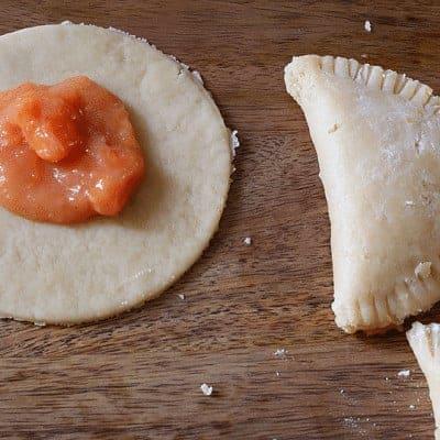 Perfect hand-sized peach pies- pie filling in the middle of individual-sized crust.
