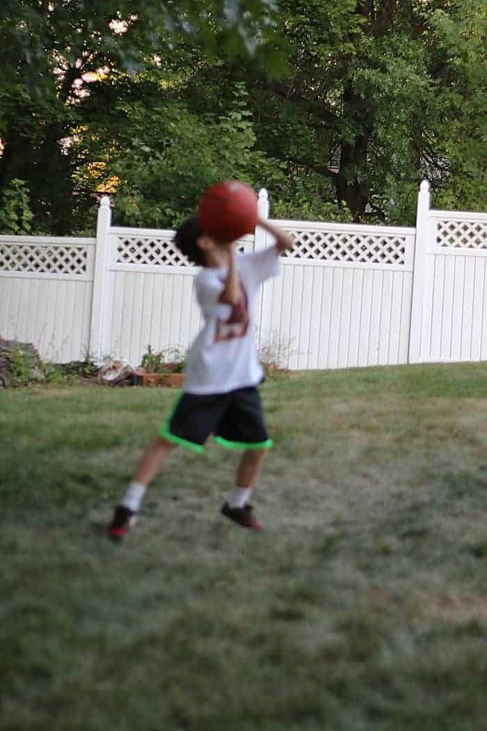 Playing basketball in the yard
