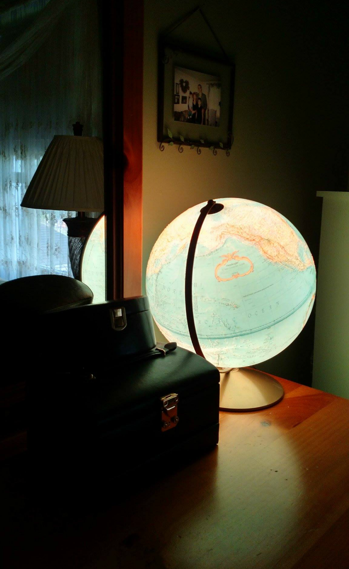 Dresser with vintage light-up globe