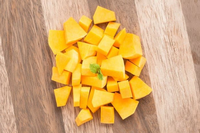 Cubed and diced butternut squash on cutting board