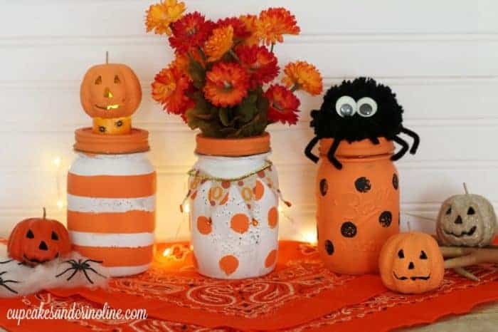 Halloween Mason Jars painted stripes and polka dots from cupcakesandcrinoline.com