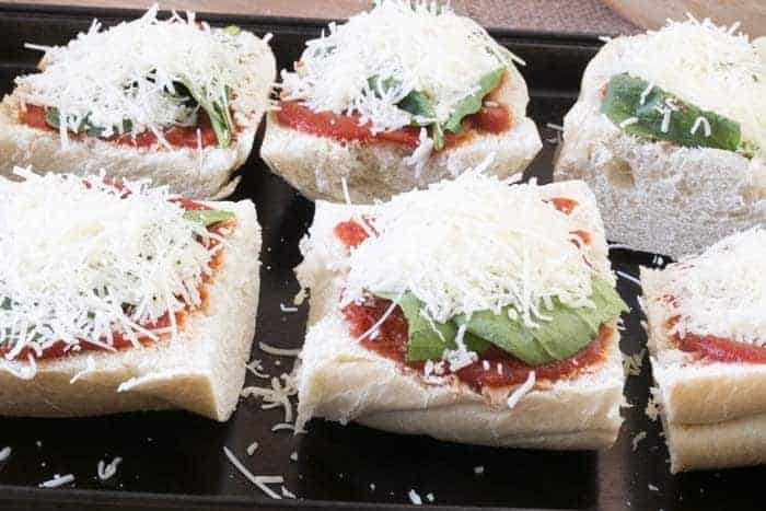 Easy and delicious, this Taco French Bread Pizza is ready in less than 30 minutes! from cupcakesandcrinoline.com
