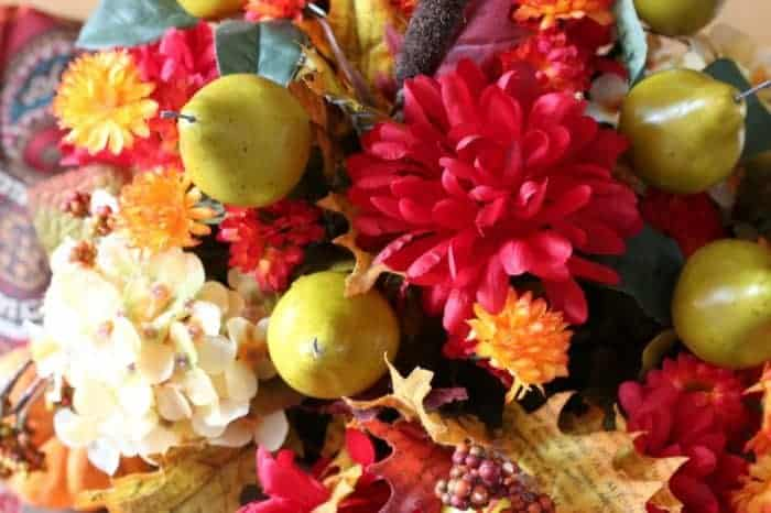 Faux flowers to create a lush and beautiful centerpiece