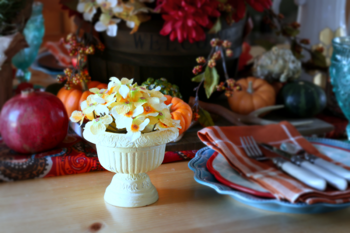Faux hydrangeas in a small metal urn - Thanksgiving tablescape
