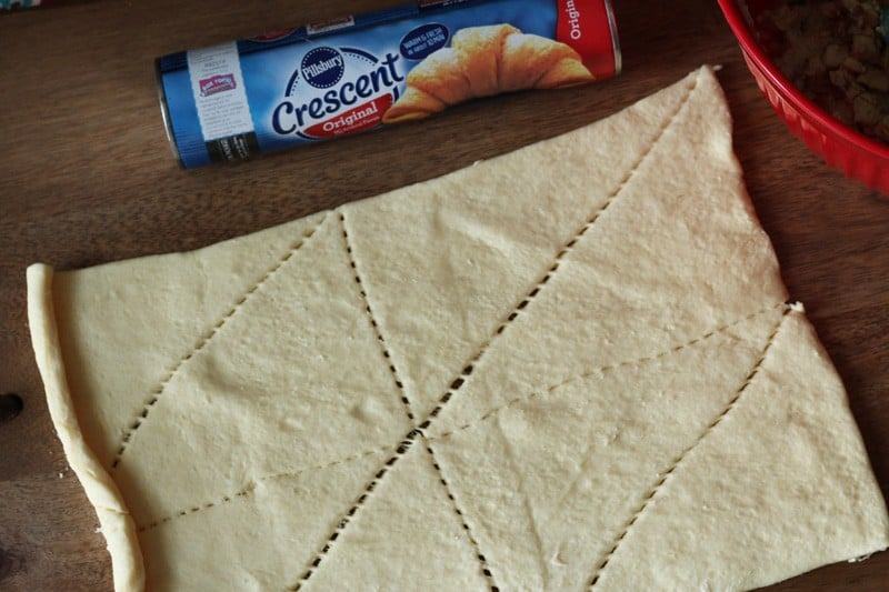 Crescent roll recipe - crescent rolls out of package and flattened out.