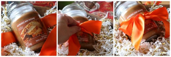 Orange satin ribbon tied on to jar candle for a DIY hostess gift