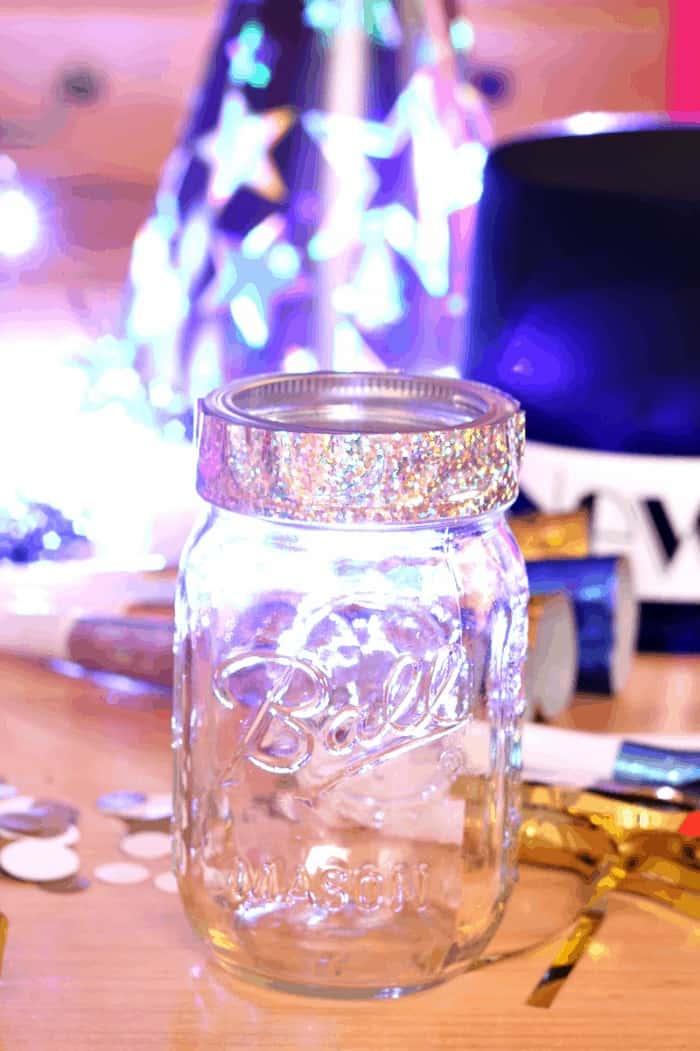 Ball mason jar with holographic tape on rim