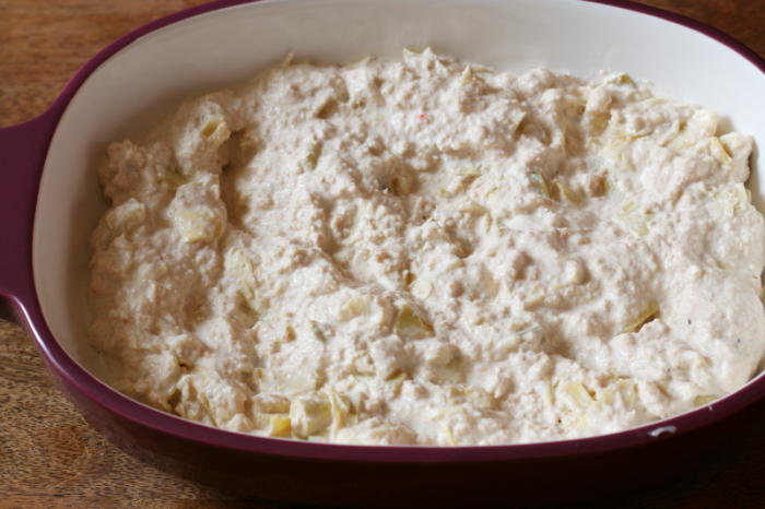 Hot Artichoke Dip in oven safe dish and ready to be baked.