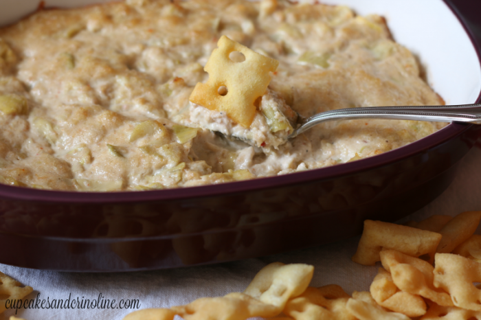 Hot artichoke and crab dip close up with crackers ready to eat!