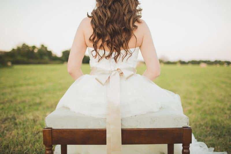 How to make a bow - back view of a beautiful dress with a large satin ribbon bow