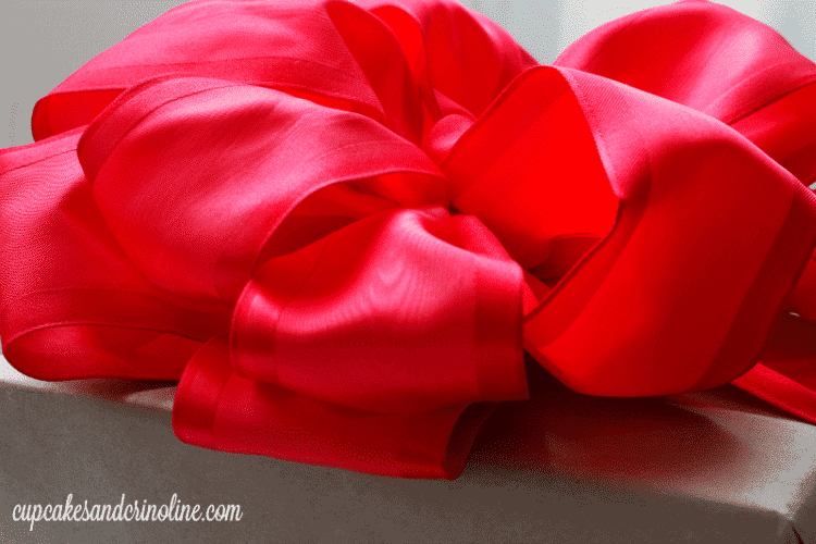 How to Make a Bow - side view of beautiful taffeta bow on top of gift box