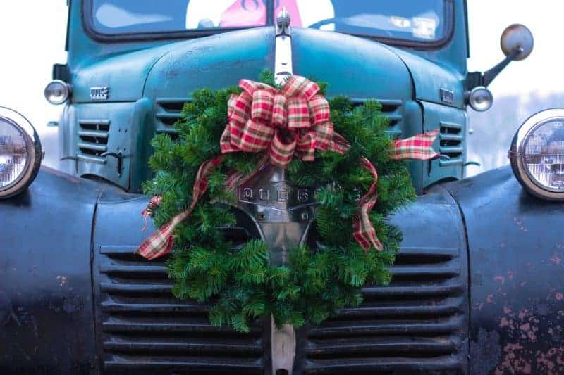 How to make a bow - large red plaid bow on top of an evergreen wreath on the grill of a vintage dodge truck