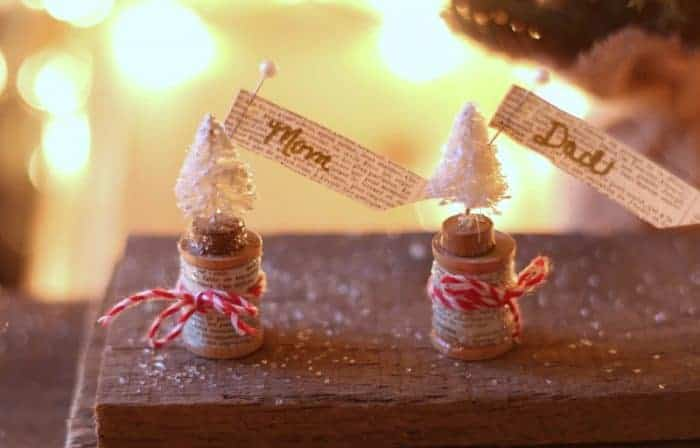 Bottle brush trees atop wooden spools with vintage paper and glitter. The perfect Christmas ornament. cupcakesandcrinoline.com