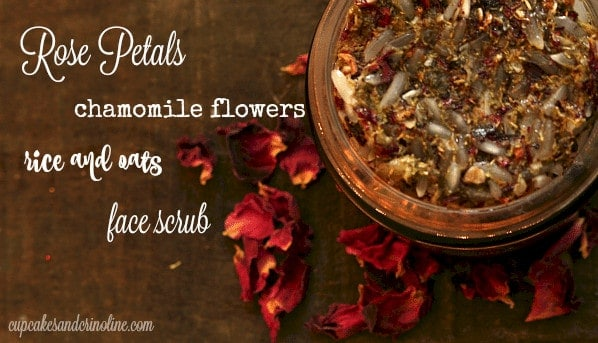 Rose petal, chamomile flowers, rice and oats homemade face scrub in a small glass jar.