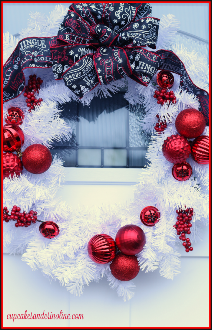 White Christmas Wreath with red ornaments and accents and Chalkboard black, red and white ribbon at cupcakesandcrinoline.com