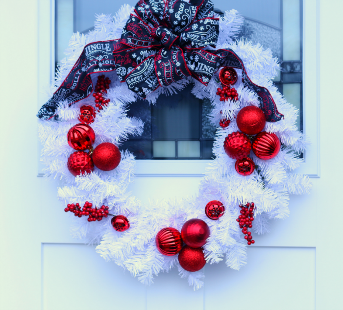 White Christmas Wreath with red ornaments and red, white and black ribbon
